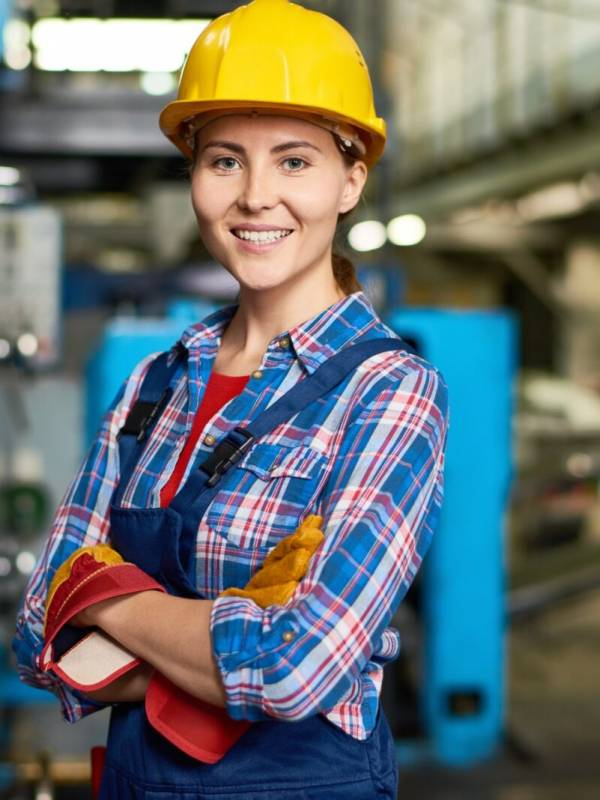 Happy Young Woman Working at Factory